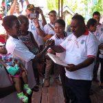 Bupati Asmat memberikan dana secara simbolis kepada penerima manfaat di Asmat